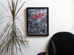 black white and red framed abstract art