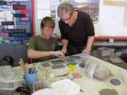 FAME Academy art teacher Glenna Pace works with student Jarrod Rounds on a  slab construction project using clay. The FAME Academy has been named the  recipient of the Oklahoma Award for Outstanding Achievement in Alternative  Education ...