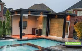 This strikingly modern cabana houses a media room, change room and bathroom  with shower.