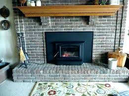 installing a wood burning fireplace in an existing home a low profile gas fireplace is installed in this lake home for in state install wood burning