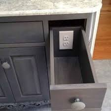 the second option is to install a proper electrical in the back of the drawer this requires an with a closed or covered back panel