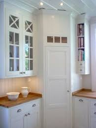 Corner pantry in White, scandinavian kitchen. I love the narrow shelves for  books to
