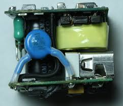 ipad charger teardown inside apple s charger and a risky phony inside the iphone charger input inductor green y capacitor blue