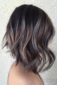 y short blonde hair with dark brown highlights