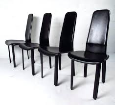 this beautiful set of four dining chairs offer a wonderful mix elegant modern style high back metal dining chairs