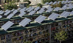 nearly half of spain s electricity came from renewables last month solar panels fill the roofs of mausoleums at the cemetery in santa caloma de gramenet