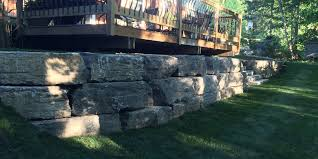 Backyard Retaining Wall Designs Fascinating RETAINING WALLS ARMOUR STONE D R Landscape Group Niagara