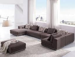 sitting room furniture ideas. Living Room : Outstanding Sitting Furniture Ideas With U Shape Brown Fabric Sofa And White Fur Carpet Also Square Ottoman Plus Transparent Window R