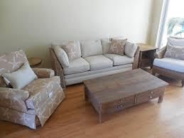grey banana leaf sofa starfish swivel chair reclaimed wood coffee table tropical living
