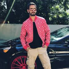 scott disick poses in a louis vuitton x supreme jacket and ralph lauren pants upscalehype