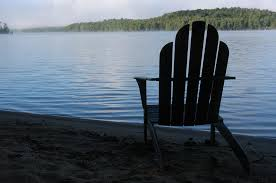 An Adirondack Chair Silhouetted Photograph by Stacy Gold
