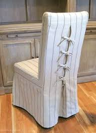 love the corseted slipcovers on these dining chairs the ties are so cute parson