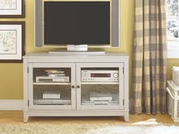 explore gallery of black tv stands with gl doors showing 11