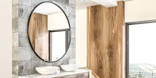 round mirror hanging above it