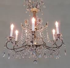 an italian genoese crystal chandelier circa 1920 featuring a giltwood and ivory painted stem