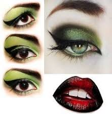 witch make up green eyes and red black lips for