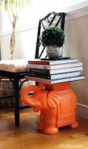 orange garden stool coffee table books stacked on an orange ceramic elephant garden orange metal garden stool