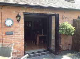 folding patio doors. Bi-fold Patio Door With Black Aluminum Frame For Country House Folding Doors D