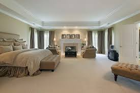 big master bedrooms couch bedroom fireplace: this spacious carpeted master bedroom has an enormous tray ceiling with vents and recessed lighting