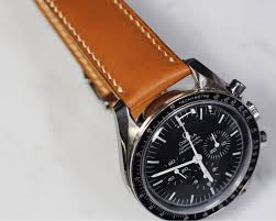 handmade handstitched watch strap in hermès golden barenia leather for clients omega sdmaster luxury watches on carou