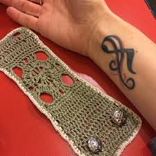 Wrist tattoo cover and crocheted earrings   marni made it & my music tattoo Adamdwight.com