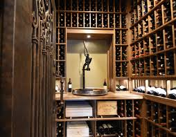 small wine storage closet with built in decanting station plus separate bourbon room
