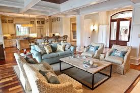 kiawah family home example of a coastal open concept living room design in charleston with gray room style furniture furniture in style