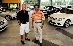 mice gabel the post standardjoe and michael romano stand in the showroom of their renovated mercedes benz dealership in fayetteville