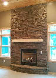 stack stone fireplaces with plasma TV mounted: