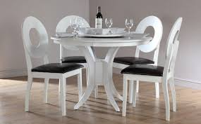 image of white round kitchen table and chairs