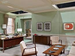 new office interior design. An Office With White Chairs, Wooden Desk And Coffee Table. Mint Walls. Tour New Interior Design
