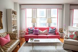 pink sofa and striped pillows