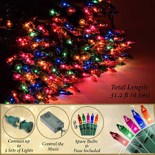 Holiday Essence Set Of 140 Indoor Multi Color Musical Christmas Lights Plays 25 Classical Holiday Songs 8 Function Chaser Green Wire 26 Ft