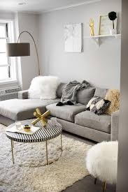 Living Room With White Furniture Learn How To Make A Small Living Room Look Bigger With Mirrors