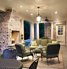 hampton bay patio furniture porch traditional with area rug brick fireplace surround ceiling fan ceiling lighting