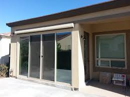 using 12 by 8 sliding glass door as part of the patio enclosure a roll down sunscreen is installed above the door