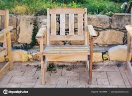 wooden outdoor furniture lounge chairs in hotel garden invite you to relax stock photo