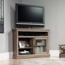 teknik office barrister home corner tv stand in salt oak finish with space for a 42in tv two adjule shelves safety tempered glass door and remov