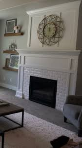 White subway tile fireplace with craftsman mantel. LOVE