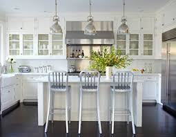 white kitchen. All-White Kitchen With Black Floor White Scullery-type Cabinets Mingle Glossy Subway Tiles, Marble Countertops, And Stainless Steel Appliances To
