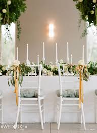 stylish white reception chairs decorations with flowers