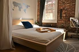 world market bedding modern bedroom and brick wall curtains ds loft map platform bed radiator wall decal white bedding white trim window casing