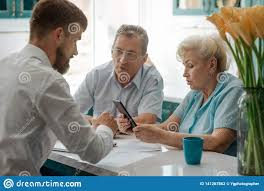 Financial Advisor Retirement Financial Advisor Helps Old Couple Stock Photo Image Of