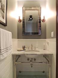 bathroom with gray walls and white subway tiles
