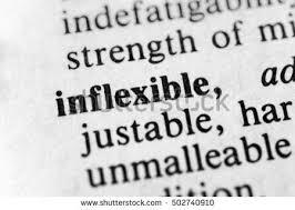inflexible. inflexible