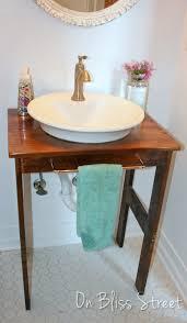 wood vanity with white vessel sink