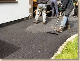Paving Expert Aj Mccormack And Son Laying Tarmacadam