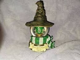 Harry potter golden snitch music box opens to reveal horcrux. Harry Potter Slytherin Musical Water Globe San Francisco Music Box Nib Ebay