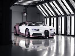 The bugatti costs 1,700,000 dollars. Bugatti Shows Off Pink Chiron Sport With Silk Rose Accents