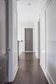 chic hallway features white walls ed with gray paneled doors adorned with polished nickel door